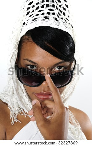 Portrait of young african american female wearing sunglasses isolated