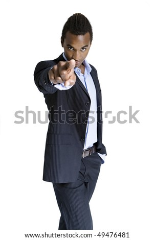 Portrait of young African American man pointing finger, studio shot - stock photo