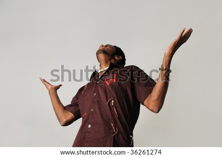 Portrait of young african american man with open arms - stock photo