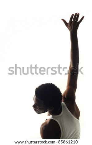 Portrait of young african american man with raised arm isolated on white - stock photo