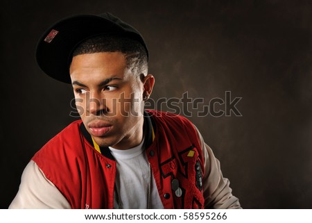 Portrait of young African American wearing baseball hat - stock photo