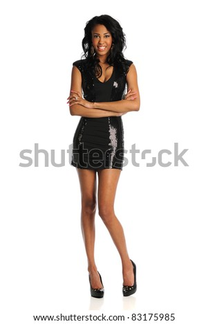 Portrait of young African American woman standing over white background - stock photo