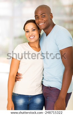portrait of young african couple standing at home - stock photo