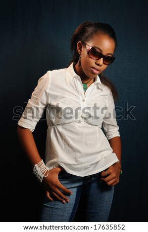 Portrait of young african female fashion model with sunglasses - stock photo