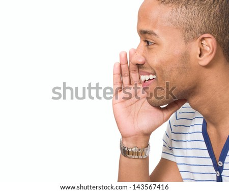 Portrait Of Young African Man Whispering Over White Background - stock photo