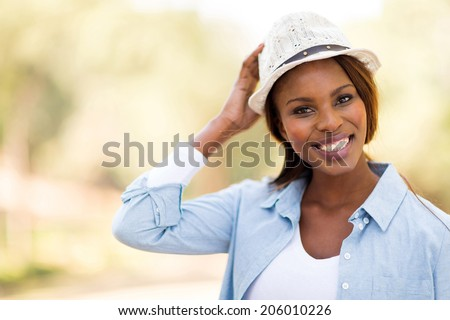 portrait of young african woman outdoors - stock photo