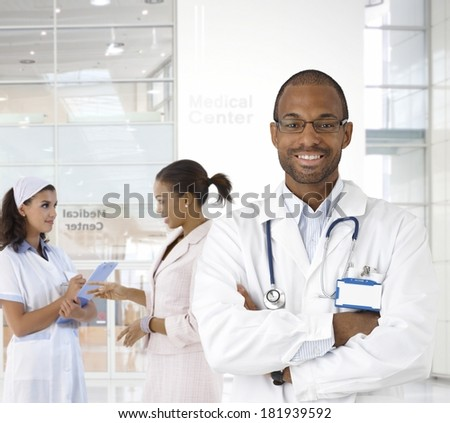 Portrait of young afro-american doctor at medical center. - stock photo