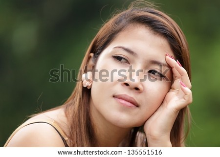 Portrait of young and beautiful Asian woman, Thailand - stock photo