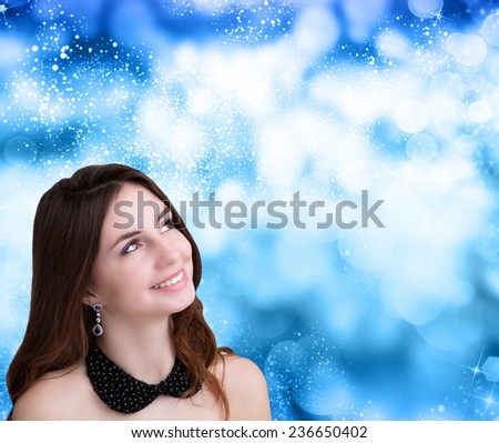 Portrait of young and beautiful woman over winter Christmas background  - stock photo