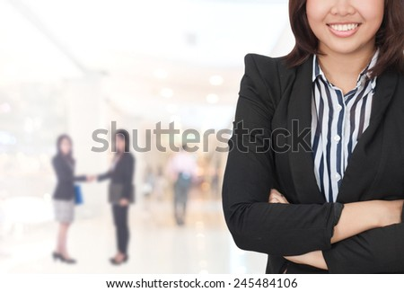 Portrait of young asia business woman in her office. - stock photo