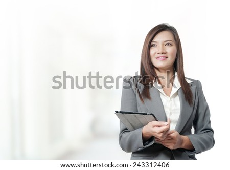 Portrait of young asia business woman in her office.Mixed Asian / Caucasian businesswoman. - stock photo