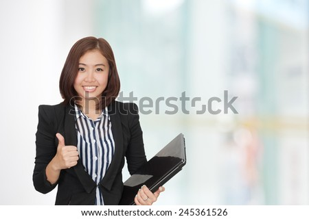 Portrait of young asia business woman in her office.Mixed Asian / Caucasian businesswoman.