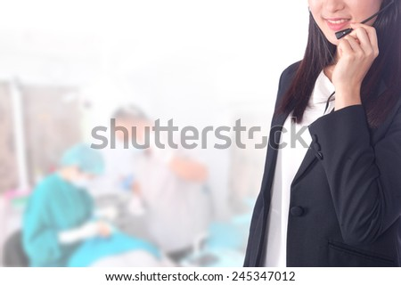 Portrait of young asia business woman or call center in her office.Mixed Asian / Caucasian businesswoman. - stock photo
