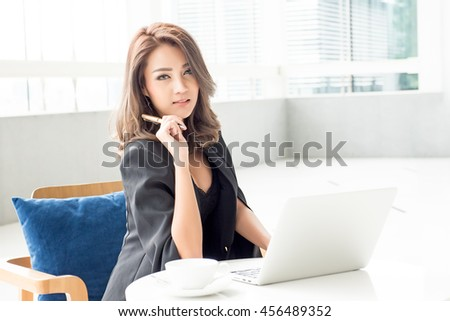 Portrait of young asia business woman working in the office