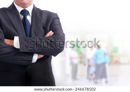 Portrait of young asia businessman has office background .cross one's arm, - stock photo
