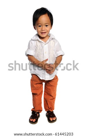 Portrait of young Asian boy standing over white background