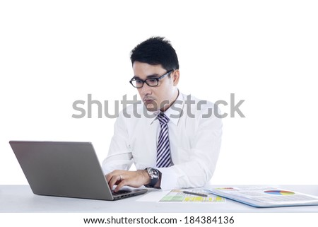 Portrait of young asian businessman typing on laptop computer. isolated on white background - stock photo