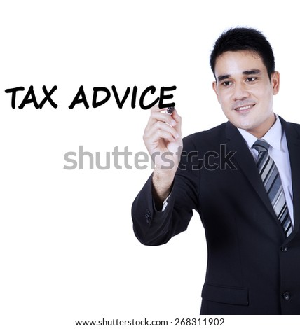 Portrait of young asian businessman wearing formal suit and writes a text of tax advice on whiteboard - stock photo