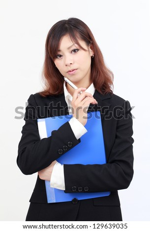Portrait of young asian businesswoman thinking