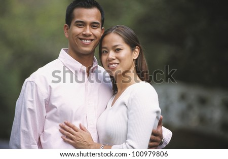 Portrait of young Asian couple outdoors
