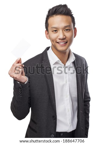 portrait of young asian man showing a visit card - stock photo