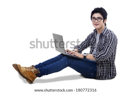 Portrait of young asian man study using laptop isolated on white background - stock photo