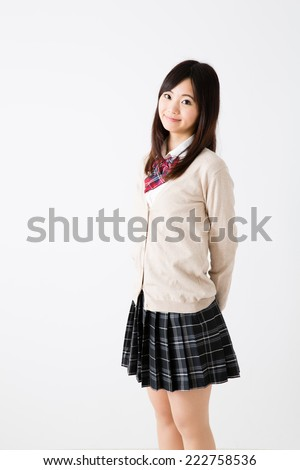 portrait of young asian student on white background - stock photo