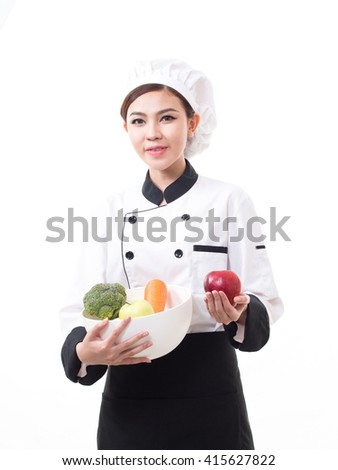 Portrait of young Asian woman chef on white background. - stock photo