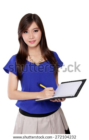Portrait of young Asian woman holding pen and notebook, isolated on white background - stock photo