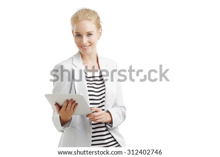 Portrait of young assistant holding hands digital tablet and smiling. Isolated on white background.  - stock photo