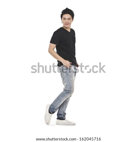 portrait of young attractive casual man wearing black T-shirt, jeans