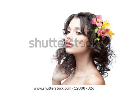 portrait of young attractive caucasian woman with lily flowers in hair