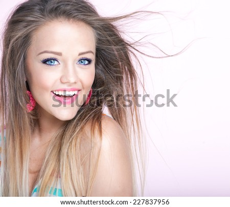 Portrait of young attractive cheerful woman - stock photo