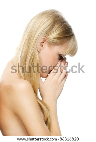 Portrait of young attractive fair-haired woman against white background. - stock photo