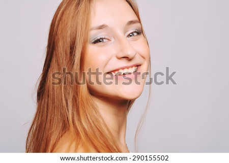 Portrait of young attractive girl. Closeup face of a caucasian model looking at camera. - stock photo