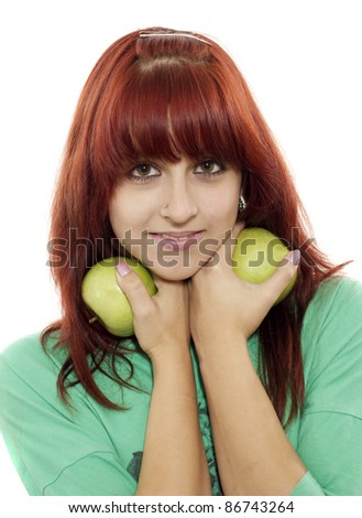 Portrait of young attractive girl with green apple - stock photo