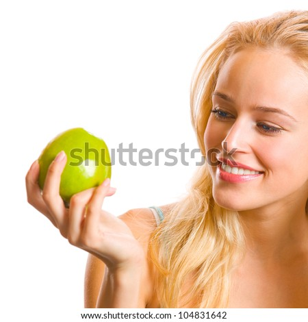 Portrait of young attractive happy smiling woman looking at apple, isolated over white background - stock photo