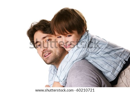 Portrait of young attractive smiling man playing with his little cute son on white background - stock photo
