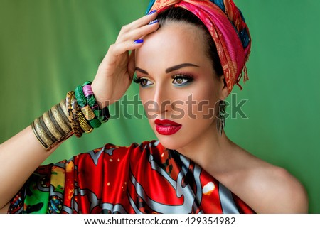 portrait of young attractive woman in african style on colorful background - stock photo