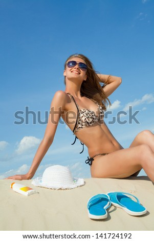 Portrait of young attractive woman on the beach - stock photo