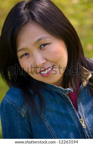 Portrait of young attractive woman outdoors