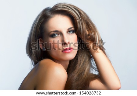 Portrait of young attractive woman - studio shot - stock photo