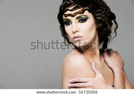 Portrait of young attractive woman with dark hair. - stock photo