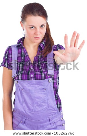 Portrait of young attractive woman with long red hair, with pony tail, wearing purple checked shirt, showing stop sign with her hand - isolated on white - stock photo