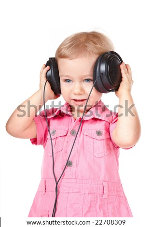Portrait of young baby girl listening music via phones