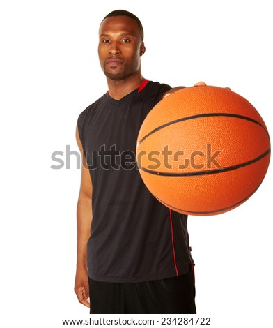 Portrait of young basketball player with ball standing isolated over white background - stock photo