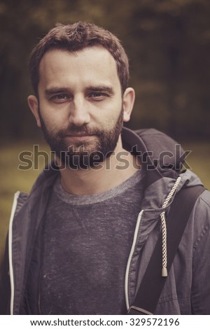 Portrait of young bearded man. Retro film filtered, instagram style. - stock photo