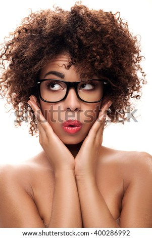 Portrait of young beautiful african american girl with afro. Girl wearing eyeglasses. Closeup photo. Studio shot. - stock photo