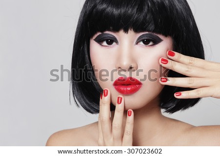 Portrait of young beautiful asian girl with stylish bob haircut and red lipstick - stock photo