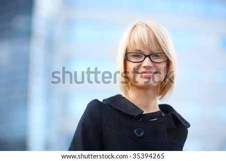 Portrait of young beautiful blond businesswoman, Close-up, shallow DOF. - stock photo